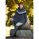 Poncho med zig-zak-mønster i Evita 893102